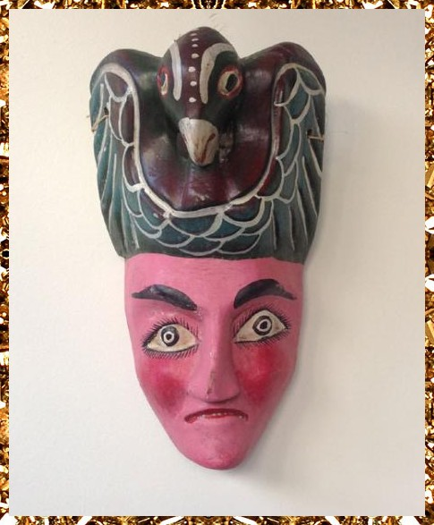 I'm a cool decorative object, a unique vintage mask to hang on your wall.