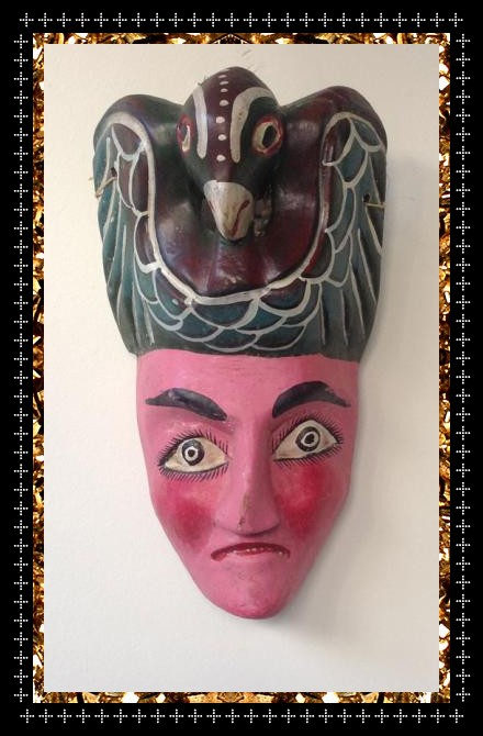 A bird on the head is worth two in the bush. Check me out, I'm one off vintage mask ready to hang on your wall.